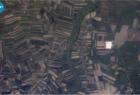 Pola z jasnymi szklarniami przy Puszczy -05.06 2015